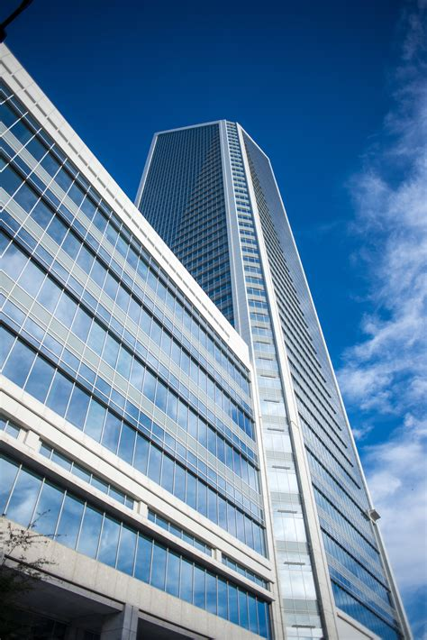 Free photo: White Frame Glass High Rise Building Under